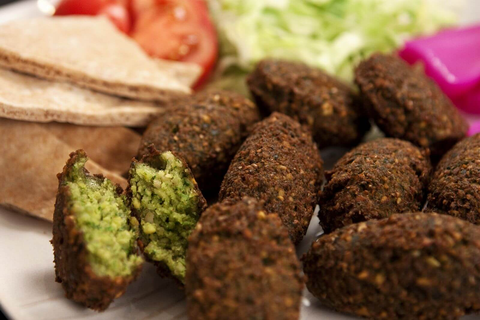 Falafel are flavorful, golf ball–size, fried patties made of ...